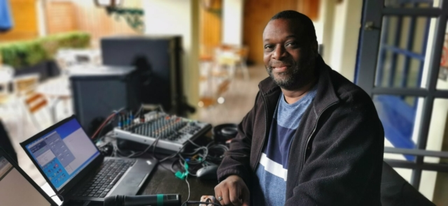 Technical and Sound guy Gehric Barreau on the control desk at The Barratts
